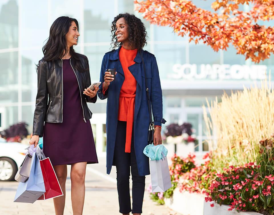Two women walking outside Square One