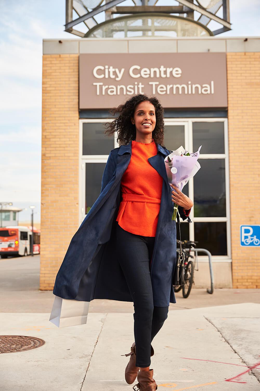Woman walking past City Centre Transit Terminal